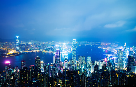 hong kong night: Hong Kong cityscape at night with victoria harbour and large group of tall buildings.