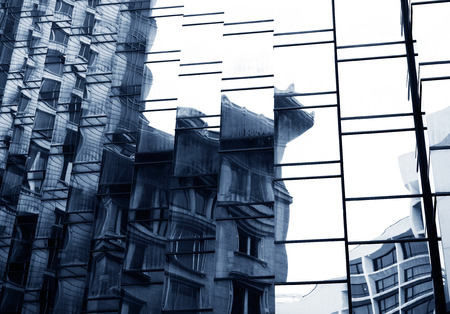 mirror on wall: modern glass silhouettes on modern building. Stock Photo