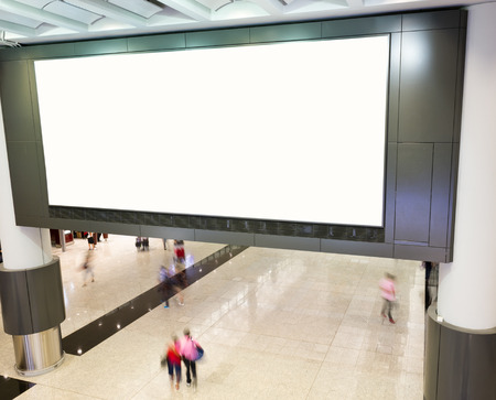 indoors: Blank billboard at the airport.