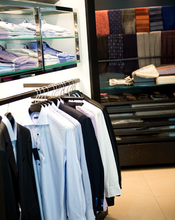 formal clothes: fashion clothing on hangers at the show