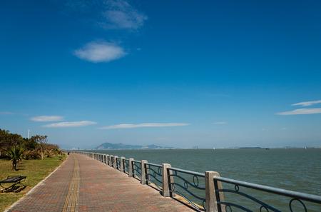 A curve walkway on seaside. photo