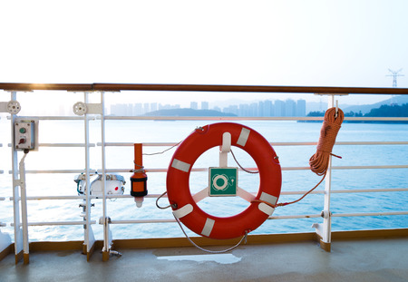 flotation: Life buoy on the deck of cruise ship.