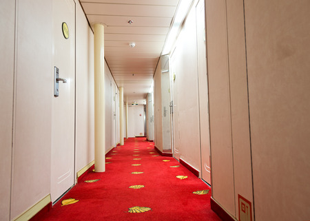 clean commercial: Empty hotel hallway in a luxury cruise.