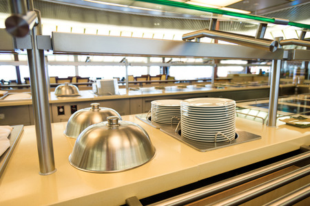 commercial equipment: Group of white plates stacked together in a hotel.