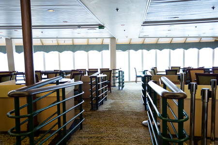 dinner cruise: Empty tables at a luxury cruise restaurant