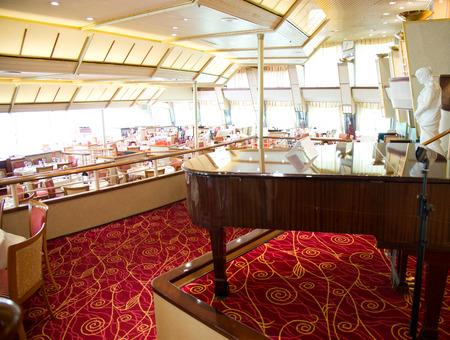 grand piano in cruise hall restaurant.