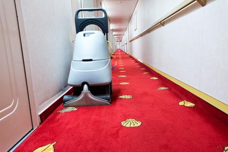 vacuum cleaner stands in the hotel corridor.