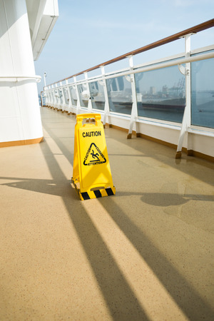 a public notice: Wet floor sign on deck of cruise ship Stock Photo