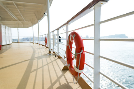 ship deck: Life buoy on the deck of cruise ship.