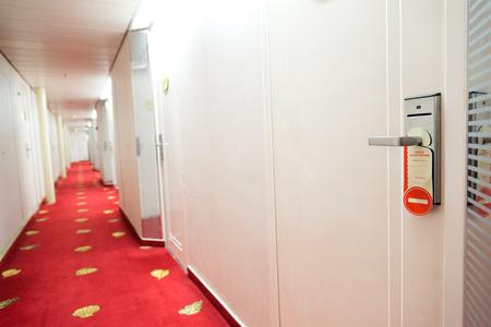 cardkey: Do not disturb sign hang on hotel door knob.