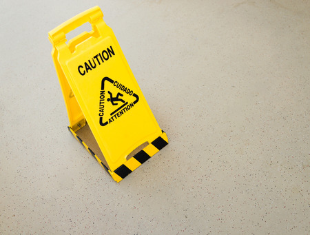 Wet floor sign on deck of cruise ship photo