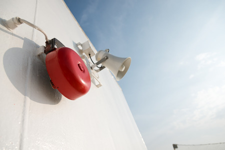 red siren: Megaphone used for emergency alarms on cruise ship.