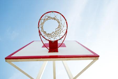 college basketball: Basketball hoop against blue sky. Stock Photo