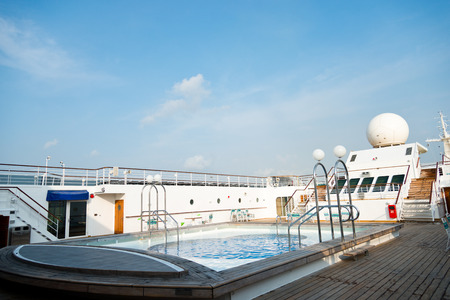 ship deck: View of top deck of cruise ship with pool. Editorial