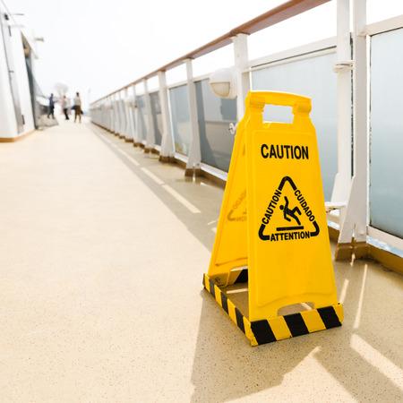 wet floor: Wet floor sign on deck of cruise ship Stock Photo