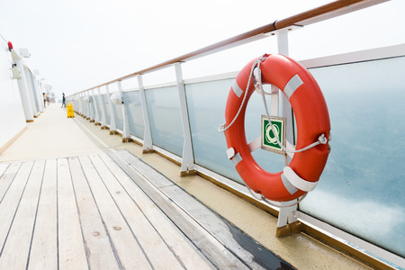 ferries: Life buoy on the deck of cruise ship.