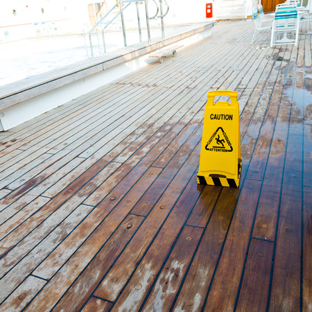 slippery: Wet floor sign on deck of cruise ship Stock Photo
