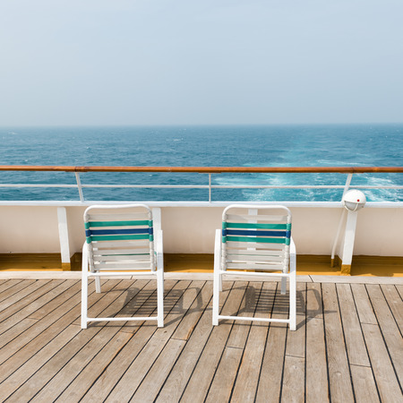 row of sun chairs  on the ship deck photo