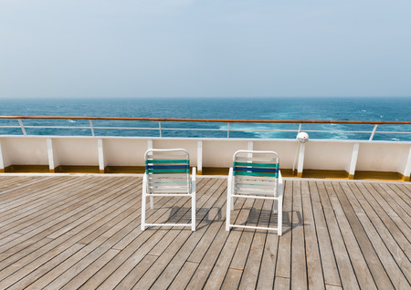 ship deck: row of sun chairs  on the ship deck