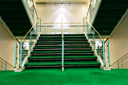 Green carpet on a stairway in a luxury cruise. photo