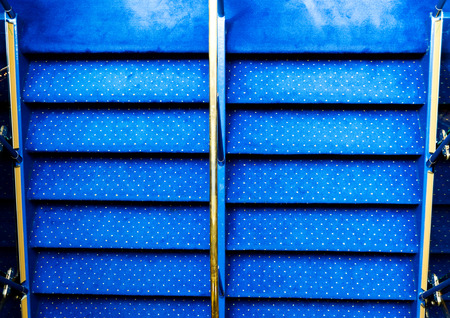 Blue carpet on a stairway in a luxury cruise. photo