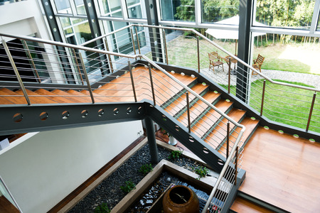 Empty office stairs with handrail in a modern building. Editorial
