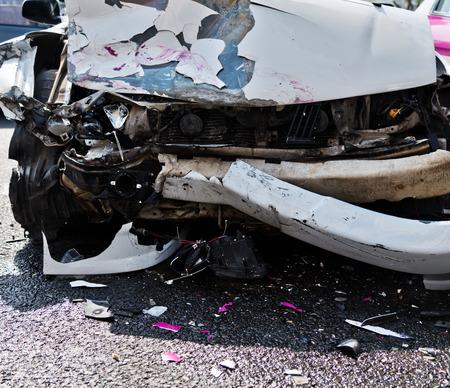 scrap car: car accident on a city street.