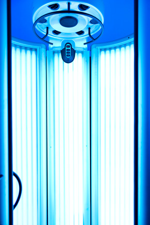 vertical wellness: interior of solarium with blue light. Stock Photo