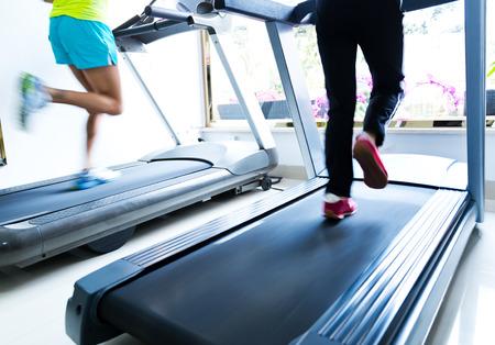 People running on a treadmill Reklamní fotografie - 35413759