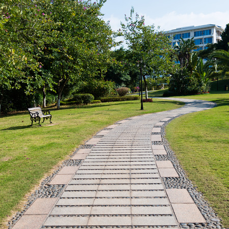 paved: Stone pathway into garden during day time