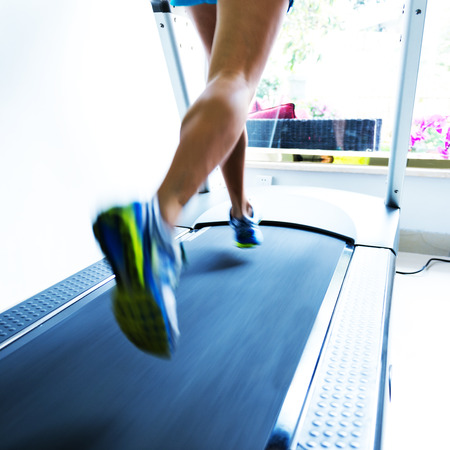 gym shoes: People running on a treadmill