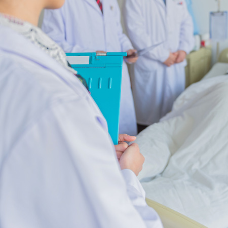 hospital patient: Medical team examining patient in hospital.