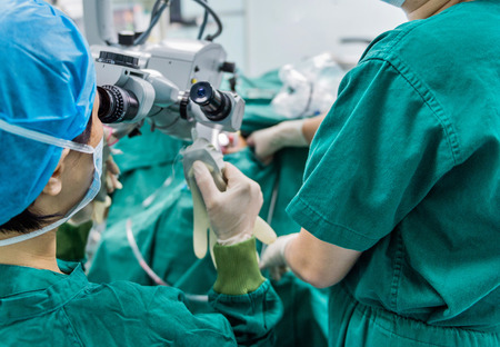 anesthesiologist: surgeons are operating in a hospital Stock Photo