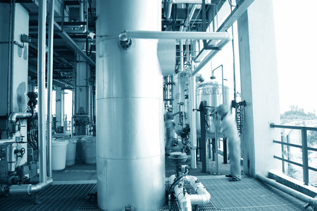 globalwarming: refinery engineers working in a large industry  Editorial