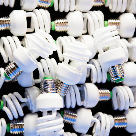 fluorescent: Group of energy efficient lightbulbs in a factory workshop Stock Photo