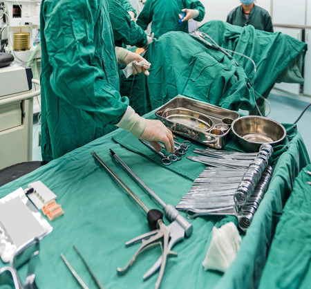 operation gown: surgeons are operating in a hospital Stock Photo