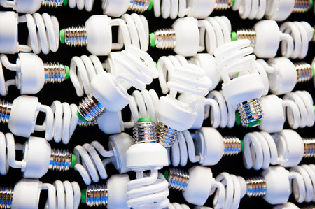 fragile economy: Group of energy efficient lightbulbs in a factory workshop Stock Photo