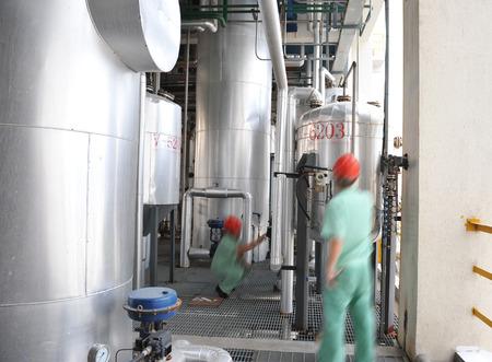 globalwarming: refinery engineers working in a large industry