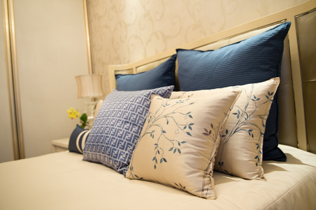 Image of comfortable pillows and bed. Standard-Bild