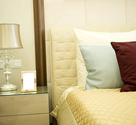 Image of comfortable pillows and bed. Stock Photo