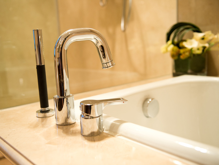 Closeup of sink and faucet in modern bathroom. Stock Photo
