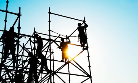 steel works: Construction workers working on scaffolding