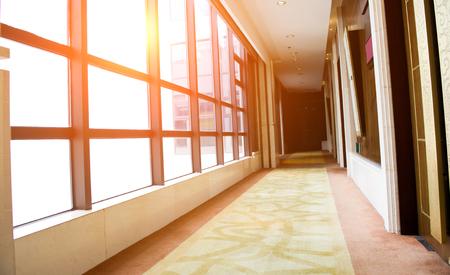 comtemporary: empty long corridor in a hotel.