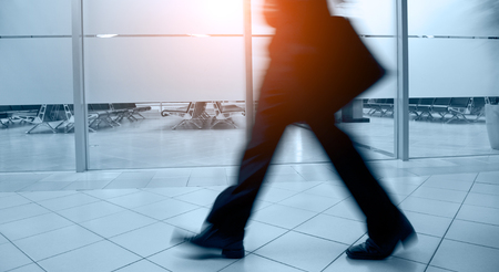 Walking business people silhouette. Blue tint. Stock Photo