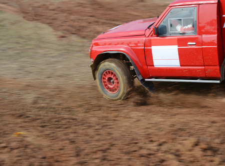 muck: Driver competing in an off-road 4x4 competition.