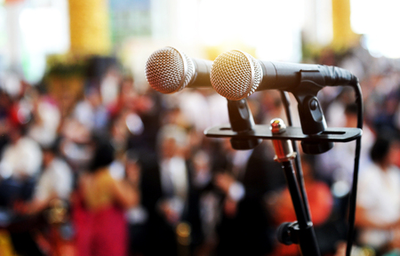 congress center: Closeup microphone in auditorium with people. Stock Photo