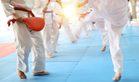 People in martial arts training exercising Taekwondo. blur motion Stock Photo