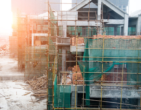 lattice window: Construction site of house with scaffolding.