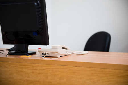 computer office: computer and telephone on a desk in a modern office Stock Photo