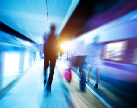 hurrying: People hurrying to catch a train. blurred motion